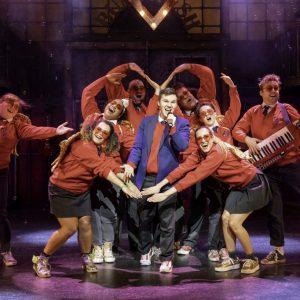 Ryan Heenan as Joe & ensemble Billionaire Boy The Musical photo by Manuel Harlan