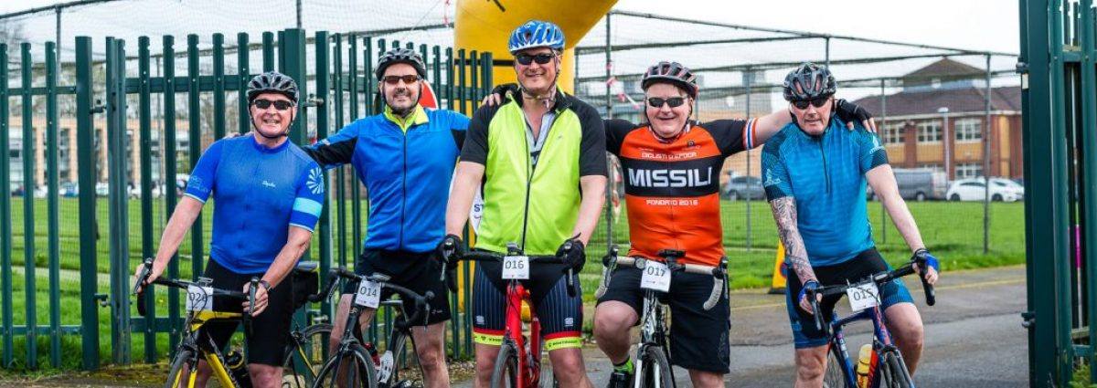 Friends at the finish line for Birmingham St Mary's Ride the Reservoir photo by Aaron Scott Richards