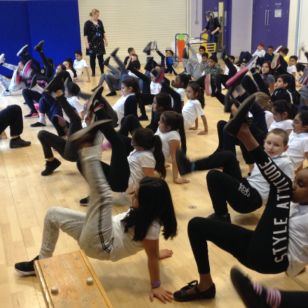 Warming up and testing flexibility at Blakesley Hall Primary School, Year 4
