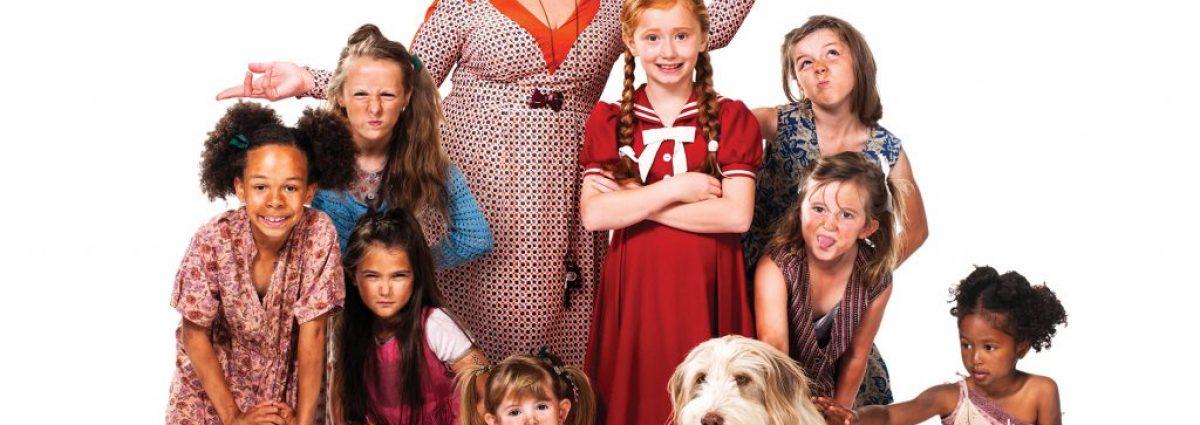 Jodie Prenger with the cast of Annie photo by Matt Crockett