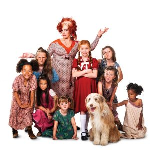 Jodie Prenger with the cast of Annie photo by Matt Crockett